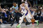 Dallas Mavericks guard Delon Wright (55) defends against Philadelphia 76ers guard Furkan Korkmaz (30) during the second half of an NBA basketball game in Dallas, Saturday, Jan 11, 2020. (AP Photo/Michael Ainsworth)