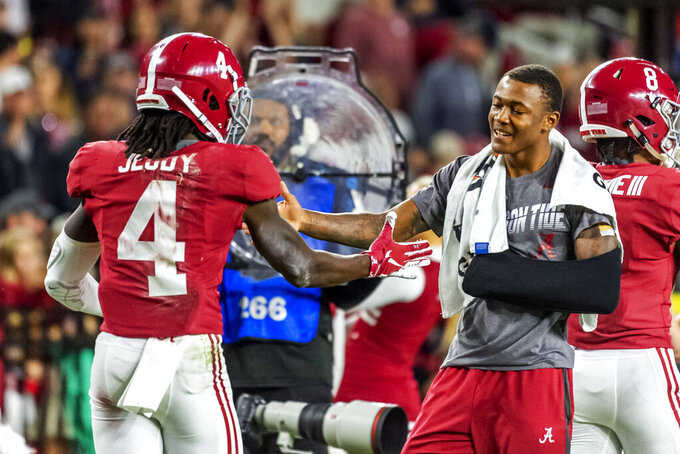 Alabama wide receiver Jerry Jeudy (4) gets congratulations from Alabama wide receiver DeVonta Smith during the second half of an NCAA college football game, Saturday, Oct. 26, 2019, in Tuscaloosa, Ala. (AP Photo/Vasha Hunt)