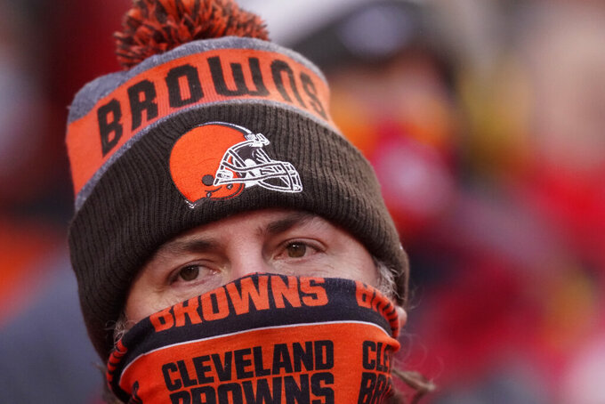 A Cleveland Browns fan watches from the stands during the second half of an NFL divisional round football game between the Kansas City Chiefs and the Cleveland Browns, Sunday, Jan. 17, 2021, in Kansas City. (AP Photo/Charlie Riedel)