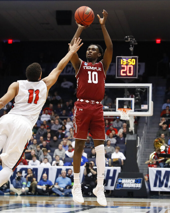 Temple's Shizz Alston Jr. (10) shoots over Belmont's Kevin McClain (11) during the second half of a First Four game of the NCAA college basketball tournament, Tuesday, March 19, 2019, in Dayton, Ohio. (AP Photo/John Minchillo)