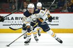 Buffalo Sabres center Jack Eichel skates with the puck against the Arizona Coyotes during the second period of an NHL hockey game Saturday, Feb. 29, 2020, in Glendale, Ariz. The Sabres front office and roster have undergone numerous changes in the seven months since captain Jack Eichel said he was fed up with losing after Buffalo missed the playoffs for a ninth consecutive year. (AP Photo/Ross D. Franklin)