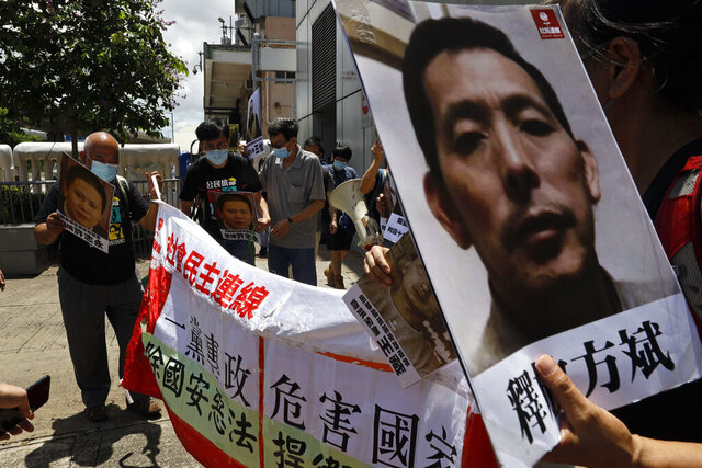 Pro-democracy demonstrators hold up portraits of jailed Chinese civil rights activists, lawyers and legal activists as they march to the Chinese liaison office in Hong Kong, Thursday, June 25, 2020. They demand to abolish the national security law and defend human rights and freedom in Hong Kong. (AP Photo/Kin Cheung)
