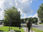 A Vermont State Police trooper involved in the search and lockdown of buildings in Montpelier, Vt., walks down the road carrying two guns on Friday, Aug. 30, 2019. No gunman was found in the search as of Friday late afternoon following a report of a person with a gun. (AP Photo/Lisa Rathke)
