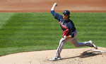 Atlanta Braves starting pitcher Kyle Wright throws agains the New York Mets during the second inning of a baseball game, Sunday, Sept. 20, 2020, in New York. (AP Photo/Noah K. Murray)