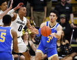 UCLA guard Jules Bernard, back right, passes the ball to guard Armani Dodson, front, as Colorado guard Shane Gatling defends in the second half of an NCAA college basketball game Thursday, March 7, 2019, in Boulder, Colo.(AP Photo/David Zalubowski)