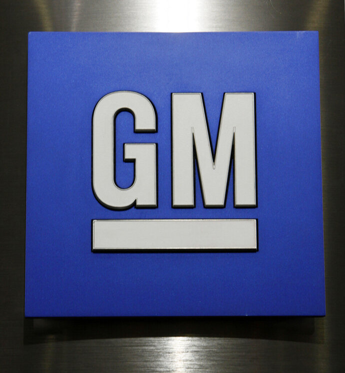 FILE - This Jan. 25, 2010, file photo, shows a General Motors Co. logo during a news conference in Detroit.  More than 1,350 temporary workers at 14 General Motors facilities in the U.S. will get full-time positions before the end of March, 2020, the company says. The workers will start at $21 to $24 per hour depending on their seniority. They'll get improved health care benefits, company 401(k) contributions and annual profit-sharing checks.    (AP Photo/Paul Sancya, File)