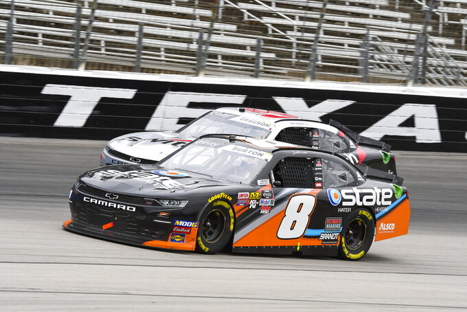 Drivers Jeb Burton (8) and Noah Gragson, background, battle for position during a NASCAR auto race at Texas Motor Speedway, Saturday, March 30, 2019, in Fort Worth, Texas. (AP Photo/Larry Papke)