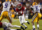 Alabama wide receiver Jerry Jeudy (4) carries against LSU safety Grant Delpit (9) and linebacker Jacob Phillips (6) on a pass play in the first half of an NCAA college football game in Baton Rouge, La., Saturday, Nov. 3, 2018. (AP Photo/Gerald Herbert)