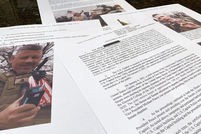 This photo shows part of the Justice Department's statement of facts in the complaint and arrest warrant for Christopher Worrell. In a case involving the Jan. 6 Capitol riot defendant, U.S. District Judge Royce Lamberth held the District of Columbia's corrections director and jail warden in contempt of court on Oct. 13, and asked the Justice Department to investigate whether inmates' civil rights are being abused. Lamberth had summoned the jail officials as part of the criminal case into Worrell, a member of the Proud Boys who has been charged in the Jan. 6 attack. Capitol. He has been accused of attacking police officers with a pepper spray gel and prosecutors have alleged he traveled to Washington and coordinated with Proud Boys leading up to the siege. (AP Photo/Jon Elswick)