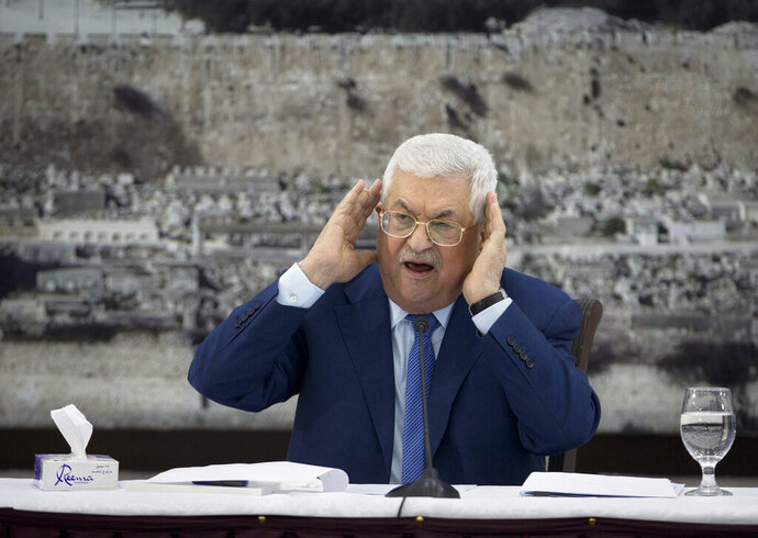 FILE - In this Dec. 22, 2018 file photo, Palestinian President Mahmoud Abbas gestures as he speaks during a meeting of the Palestinian leadership in the West Bank city of Ramallah. The Western-backed Palestinian Authority is threatening to step up pressure on Hamas amid renewed tensions in Gaza, even as Israel allows a lifeline of Qatari aid to flow directly to the Islamic militants. Abbas wants to reassert his authority over Gaza, while Israeli Prime Minister Benjamin Netanyahu seeks to preserve calm ahead of April's elections. (AP Photo/Majdi Mohammed, File)