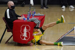 Oregon guard Chris Duarte crashes into a table during the second half of the team's NCAA college basketball game against Stanford in Stanford, Calif., Thursday, Feb. 25, 2021. (AP Photo/Jeff Chiu)