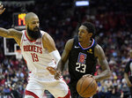 LA Clippers' Lou Williams (23) drives toward the basket as Houston Rockets' Tyson Chandler (19) defends during the first half of an NBA basketball game Wednesday, Nov. 13, 2019, in Houston. (AP Photo/David J. Phillip)