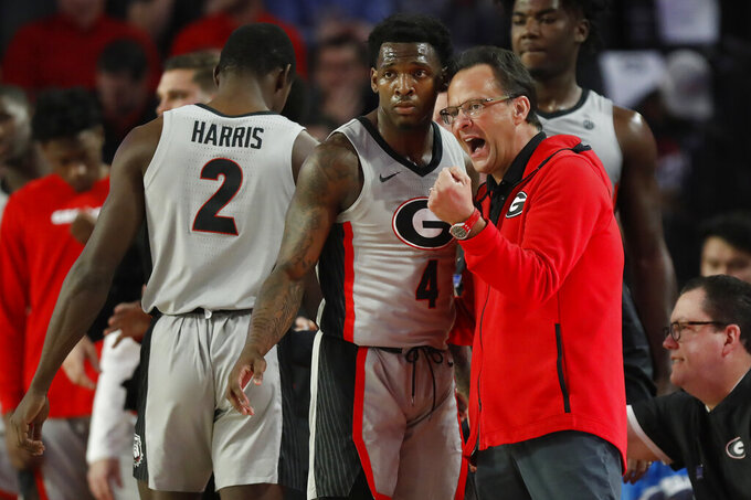 Georgia coach Tom Crean, right, speaks with Georgia's Tyree Crump (4) during an NCAA college basketball game against Mississippi in Athens, Ga., Saturday, Jan. 25, 2020. (Joshua L. Jones/Athens Banner-Herald via AP)