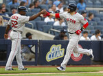 Boston Red Sox's J.D. Martinez, right, celebrates his solo home run with third base coach Carlos Febles during the first inning of a baseball game against the New York Yankees, Sunday, June 2, 2019, in New York. (AP Photo/Kathy Willens)
