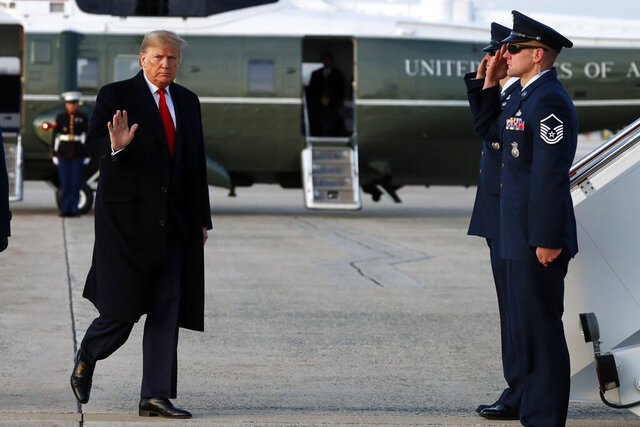 President Donald Trump boards Air Force One at Andrews Air Force Base, Md., Thursday, Jan. 9, 2020, en route to a campaign rally in Ohio. (AP Photo/ Jacquelyn Martin)