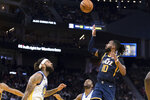 Utah Jazz guard Mike Conley (10) shoots as Golden State Warriors center Willie Cauley-Stein, left, watches in the second half of an NBA basketball game in San Francisco, Monday, Nov. 11, 2019. The Jazz won 122-108. (AP Photo/John Hefti)