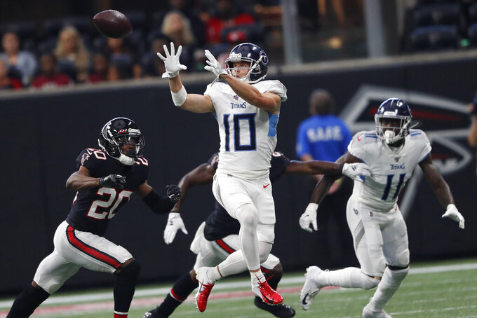 Tennessee Titans wide receiver Adam Humphries (10) prepares to make the catch against Atlanta Falcons defensive back Kendall Sheffield (20) during the first half of an NFL football game, Sunday, Sept. 29, 2019, in Atlanta. (AP Photo/John Bazemore)