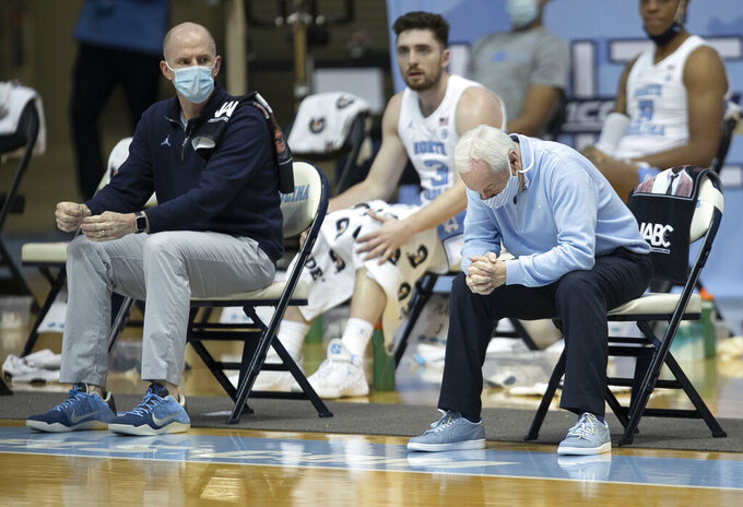North Carolina coach Roy Williams reacts to play by the team during the first half of an NCAA college basketball game against Northeastern on Wednesday, Feb. 17, 2021, in Chapel Hill, N.C. (Robert Willett/The News & Observer via AP)