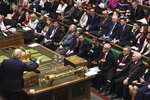 """In this handout photo provided by the House of Commons, Britain's Prime Minister Boris Johnson, left, speaks in Parliament in London, Wednesday, Sept. 25, 2019. An unrepentant Prime Minister Boris Johnson brushed off cries of """"Resign!"""" and dared the political opposition to try to topple him Wednesday at a raucous session of Parliament, a day after Britain's highest court ruled he acted illegally in suspending the body ahead of the Brexit deadline. (Jessica Taylor/House of Commons via AP)"""