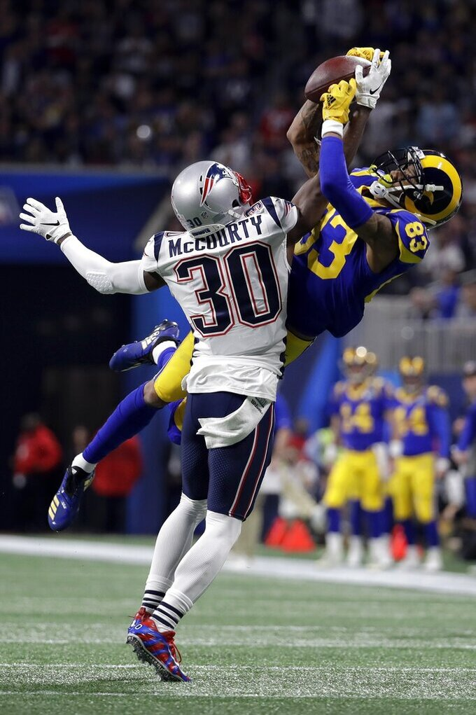New England Patriots' Jason McCourty, left, breaks up a pass intended for Los Angeles Rams' Josh Reynolds during the first half of the NFL Super Bowl 53 football game Sunday, Feb. 3, 2019, in Atlanta. (AP Photo/Chuck Burton)