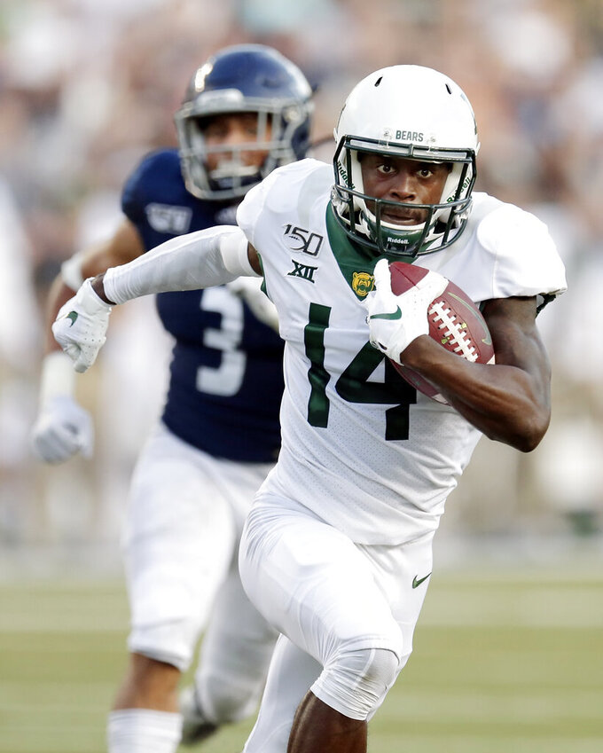 Baylor wide receiver Chris Platt (14) outruns Rice safety Naeem Smith (3) for a touchdown during the first half of an NCAA college football game Saturday, Sept. 21, 2019, in Houston. (AP Photo/Michael Wyke)