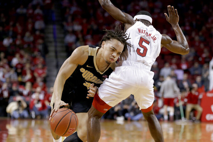 Purdue's Carsen Edwards (3) drives around Nebraska's Glynn Watson Jr. (5) during the first half of an NCAA college basketball game in Lincoln, Neb., Saturday, Feb. 23, 2019. (AP Photo/Nati Harnik)
