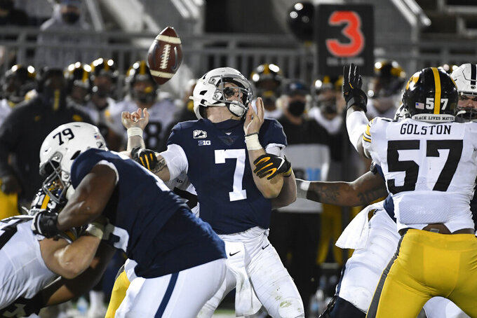 Penn State quarterback Will Levis (7) fumbles the ball while being hit by Iowa linebacker Jack Campbell (31) during the third quarter of an NCAA college football game in State College, Pa., on Saturday, Nov. 21, 2020. Iowa defeated Penn State 41-21. (AP Photo/Barry Reeger)