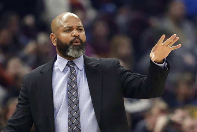 FILE - In this March 2, 2020, file photo, Cleveland Cavaliers head coach J.B. Bickerstaff gives instructions to players in the first half of an NBA basketball game against the Utah Jazz in Cleveland. The Cavs, who had their season hijacked by COVID-19, were back on the floor for individual workouts as they began cramming for an upcoming season that's only weeks away.  For now, players can only work out individually before the team is permitted to practice as a group on Friday, Dec. 4. (AP Photo/Tony Dejak, File)