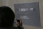 A sign with some names of the Sackler family is displayed at the Metropolitan Museum of Art in New York, Thursday, Jan. 17, 2019. The Sackler name adorns walls at some of the world's top museums and universities, including the Met, the Guggenheim and Harvard. But the family's ties to the powerful painkiller OxyContin and the drug's role in the nation's deadly opioid crisis are bringing a new kind of attention to the Sacklers and their philanthropic legacy. (AP Photo/Seth Wenig)