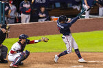 Atlanta Braves' Dansby Swanson hits a home run during the eighth inning of the team's baseball game against the Washington Nationals in Washington, Thursday, Sept. 10, 2020. (AP Photo/Manuel Balce Ceneta)