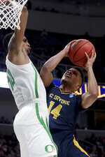 UC Irvine guard Evan Leonard, right, looks to shoot past Oregon forward Kenny Wooten during the second half of a second-round game in the NCAA men's college basketball tournament Sunday, March 24, 2019, in San Jose, Calif. (AP Photo/Jeff Chiu)
