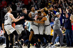 Colorado guard D'Shawn Schwartz, second from right, reacts with teammates after sinking the game-winning shot in overtime of an NCAA college basketball game against Dayton, Saturday, Dec. 21, 2019, in Chicago. Colorado won 78-76. (AP Photo/Matt Marton)