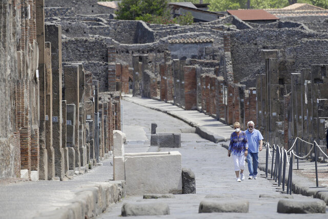 Colleen and Marvin Hewson, from the United States, visit the archaeological site of Pompeii, near Naples, southern Italy, Tuesday, May 26, 2020. The American couple waited a lifetime plus 2 ½ months to visit the ancient ruins of Pompeii together. For Colleen and Marvin Hewson, the visit to the ruins of an ancient city destroyed in A.D. 79 by a volcanic eruption was meant to be the highlight a trip to celebrate his 75th birthday and their 30th anniversary. They were among the only tourists present when the archaeological site reopened to the public on Tuesday after the national lockdown to prevent the spread of COVID-19. (AP Photo/Alessandra Tarantino)