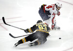 Boston Bruins left wing Brad Marchand (63) is dumped to the ice by Washington Capitals defenseman Jonas Siegenthaler (34) near the Capitals' goal during the first period of an NHL hockey game Thursday, Jan. 10, 2019, in Boston. Siegenthaler was penalized on the play. (AP Photo/Elise Amendola)