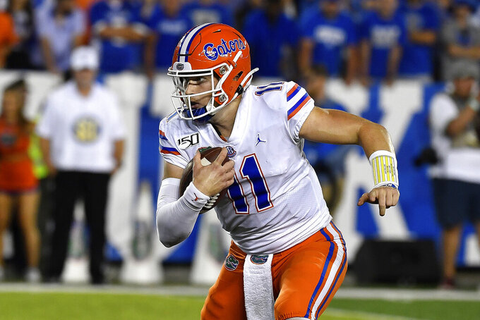 FILE - In this Sept. 14, 2019, file photo, Florida quarterback Kyle Trask (11) is shown running during the second half of an NCAA college football game in Lexington, Ky. With a collective seven career starts between them, No. 7 Auburn's quarterback Bo Nix and No. 10 Florida's Kyle Trask are set to face off in a Top 10 showdown. (AP Photo/Timothy D. Easley, File)