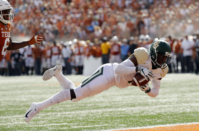 Baylor cornerback Jameson Houston (11) breaks up a pass intended for Texas wide receiver Devin Duvernay, left, during the first half of an NCAA college football game, Saturday, Oct. 13, 2018, in Austin, Texas. (AP Photo/Eric Gay)
