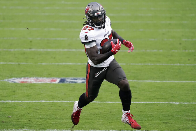 Tampa Bay Buccaneers running back Ronald Jones (27) runs against the Carolina Panthers during the second half of an NFL football game, Sunday, Nov. 15, 2020, in Charlotte , N.C. (AP Photo/Gerry Broome)