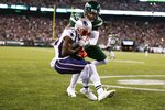 New York Jets cornerback Trumaine Johnson (22) tackles New England Patriots' Phillip Dorsett (13) as he catches a pass for a touchdown during the first half of an NFL football game, Monday, Oct. 21, 2019, in East Rutherford, N.J. (AP Photo/Adam Hunger)