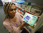 Alice White displays a package of disposal single use wipes at Pucci's Leader Pharmacy in Sacramento, Calif., Thursday, Jan. 23, 2020. A proposal by Assemblyman Richard Bloom, D-Santa Monica, that would require products that cannot be flushed down the toilet to be clearly labeled as such was approved by the Assembly Appropriations Committee, Thursday, Jan. 23, 2020. It now goes for a vote in the Assembly. (AP Photo/Rich Pedroncelli)