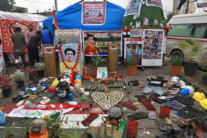 Posters of protesters who have been killed in demonstrations, their belongings, and protesters' slogans are displayed in Tahrir Square during ongoing anti-government protests in Baghdad, Iraq, Tuesday, Dec. 3, 2019. At least 400 people have died since the leaderless uprising shook Iraq on Oct. 1, with thousands of Iraqis taking to the streets in Baghdad and the predominantly Shiite southern Iraq decrying corruption, poor services, lack of jobs and calling for an end to the political system that was imposed after the 2003 U.S. invasion. (AP Photo/Hadi Mizban)