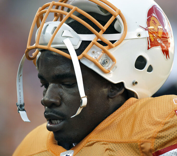 FILE - Tampa Bay Buccaneers linebacker Geno Hayes is shown during an NFL football game against the Atlanta Falcons in Tampa, Fla., in this Sunday, Dec. 5, 2010, file photo. Hayes, a former NFL linebacker who starred at Florida State, has died. He was 33. The Tampa Bay Buccaneers on Tuesday, April 27, 2021, confirmed his death. He had liver disease and had been in hospice care. (AP Photo/Chris O'Meara, File)