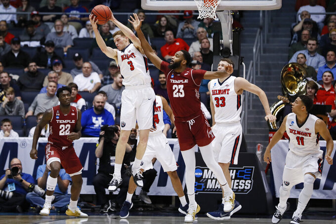 Belmont's Dylan Windler (3) rebounds against Temple's Damion Moore (23) during the first half of a First Four game of the NCAA college basketball tournament, Tuesday, March 19, 2019, in Dayton, Ohio. (AP Photo/John Minchillo)