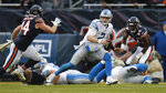 Detroit Lions quarterback Jeff Driskel (2) scrambles from Chicago Bears inside linebacker Nick Kwiatkoski (44) during the second half of an NFL football game in Chicago, Sunday, Nov. 10, 2019. (AP Photo/Charles Rex Arbogast)