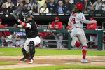 Los Angeles Angels' Brandon Marsh (16) scores past Chicago White Sox catcher Yasmani Grandal during the sixth inning of a baseball game Wednesday, Sept. 15, 2021, in Chicago. (AP Photo/Charles Rex Arbogast)