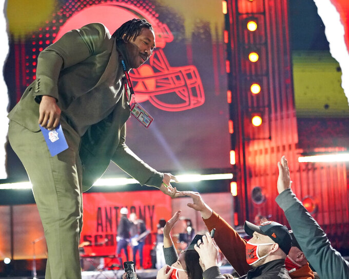 Cleveland Browns' Myles Garrett greets fans during the third round of the NFL football draft Friday, April 30, 2021, in Cleveland. (AP Photo/Tony Dejak)