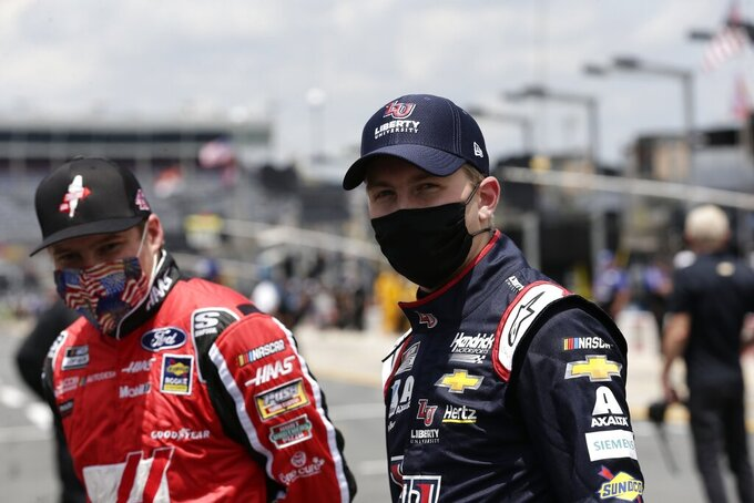 FILE - Drivers Cole Custer, left, and William Byron watch during qualifying prior to a NASCAR Cup Series auto race at Charlotte Motor Speedway Sunday, May 24, 2020, in Concord, N.C. Custer, Byron, Matt DiBenedetto and Ryan Blaney are the four drivers below the cutline headed into the knockout race. (AP Photo/Gerry Broome, File)