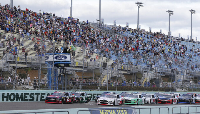 Tyler Reddick leads the field to start the NASCAR Xfinity Series auto race on Saturday, Nov. 16, 2019, at Homestead-Miami Speedway in Homestead, Fla. (AP Photo/Terry Renna)