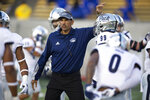 Nevada coach Jay Norvell talks to players before an NCAA college football game against California, Saturday, Sept. 4, 2021, in Berkeley, Calif. (AP Photo/D. Ross Cameron)