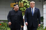 "FILE - In this Feb. 28, 2019 file photo, President Donald Trump and North Korean leader Kim Jong Un take a walk after their first meeting at the Sofitel Legend Metropole Hanoi hotel, in Hanoi. John Bolton, President Donald Trump's national security adviser, says North Korean allegations that he and Secretary of State Mike Pompeo created an atmosphere of hostility and mistrust at last month's nuclear summit in Hanoi are ""inaccurate.""  North Korea's Vice Foreign Minister Choe Son Hui said Friday that Trump was willing to talk, but was influenced by uncompromising demands by Pompeo and Bolton. She says the ""gangster-like stand of the U.S. will eventually put the situation in danger."" (AP Photo/Evan Vucci)"