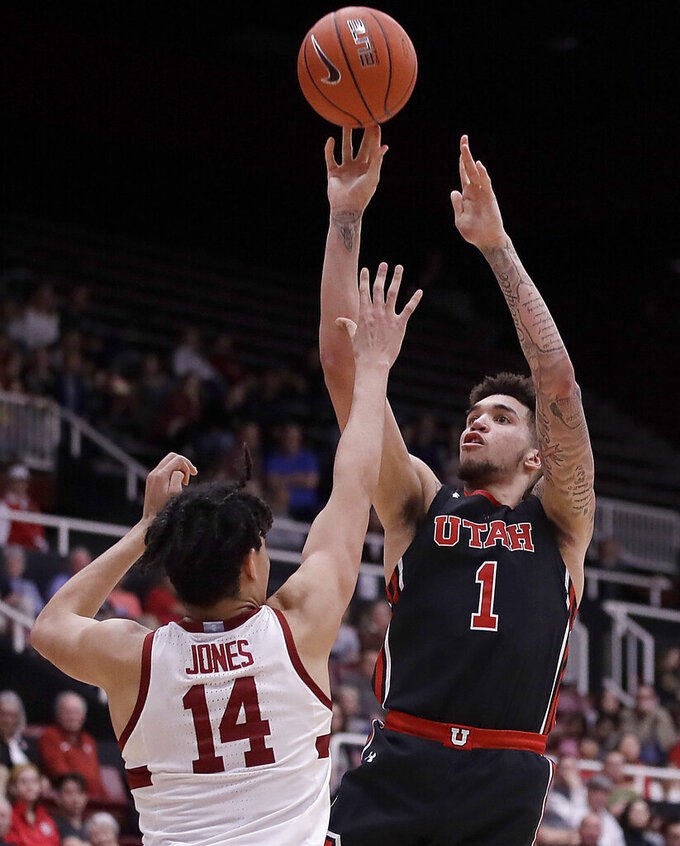 Utah's Timmy Allen, right, shoots over Stanford's Spencer Jones (14) in the second half of an NCAA college basketball game Wednesday, Feb. 26, 2020, in Stanford, Calif. (AP Photo/Ben Margot)